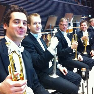 In May 2011, the happy trumpet section of Helsinki Philharmonic trying out the new and wonderful hall of the Helsinki Music Centre